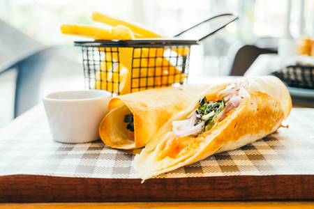 Smoked salmon with vegetable sandwich wraps - Color Filter Processing Stock Photo