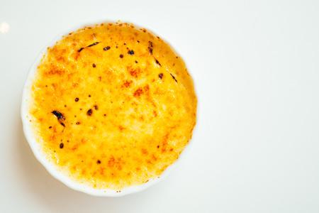 crema: Vanilla cream brulee sweet dessert in white plate - Color Filter Processing