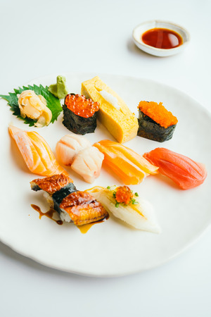 Raw and fresh nigiri sushi set in white plate - Japanese food style , Color filter processing Stock Photo - 81218596