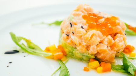 Raw fresh salmon tartare with avocado in white plate - Color Filter Processing Stock Photo - 81218597