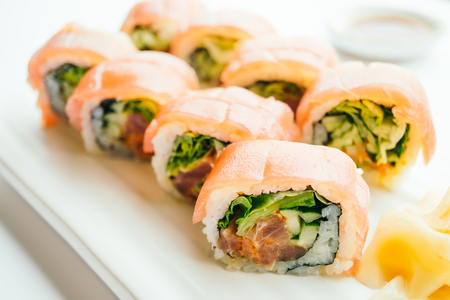 Raw fresh sushi roll with wasabi and soy sauce in white plate , Japanese food style - Color Filter Processing Stock Photo