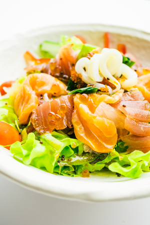 Mixed seafood and vegetable salad with salmon tuna squid and other fish sashimi in white plate - Color Filter Processing , Japanese food style Stock Photo - 81523605