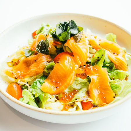 Raw fresh salmon meat sashimi with vegetable salad in white plate , Japanese food style - Filter Processing Stock Photo