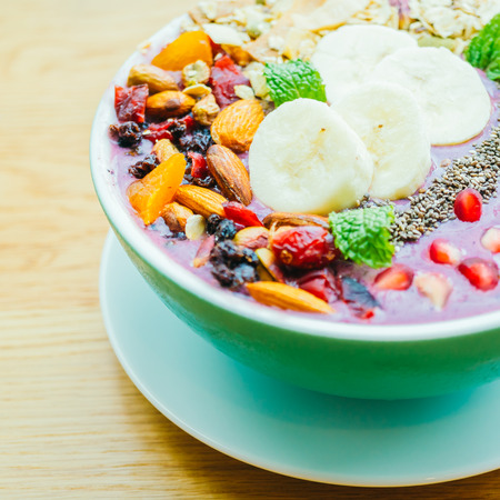 Berry smoothies with banana , almond and other mix fruits in bowl - Healthy food style Stock Photo