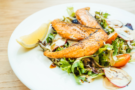 Grilled salmon fillet meat with vegetable salad in white plate - Healthy food style , Color Filer Processing