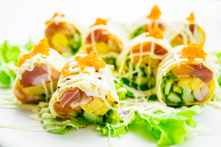 Sushi roll with tuna salmon and sweet egg inside on white plate - Color Filter Processing , Japanese food style Stock Photo - 83086655