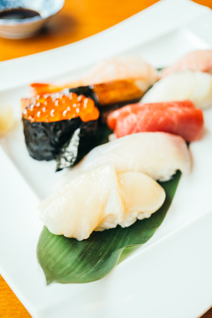 Raw and fresh sushi roll in white plate - Japanese food style , Color filter Processing Stock Photo