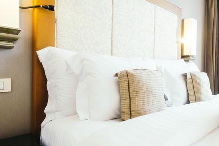 suite: Comfort pillow on bed decoration interior of bedroom Stock Photo