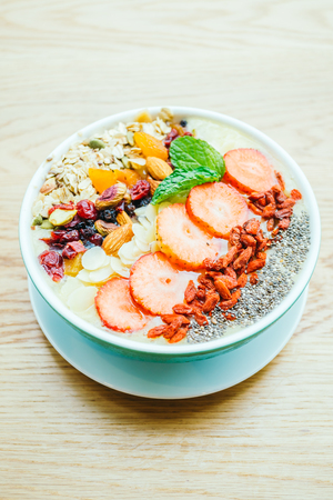 Smoothies bowl with strawberry , chia , and other - Healthy food style Stock Photo