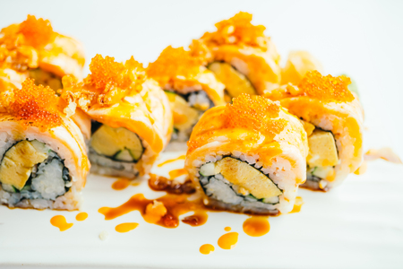 Raw fresh salmon sushi roll with sauce in white plate - Japanese food style , Color filter Processing