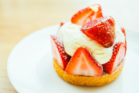 Sweet dessert with strawberry tart in white plate