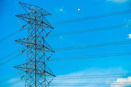 Electricity power and High voltage energy on sky background Stock Photo