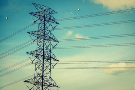 electric grid: Electricity power and High voltage energy on sky background - Vintage Filter Stock Photo
