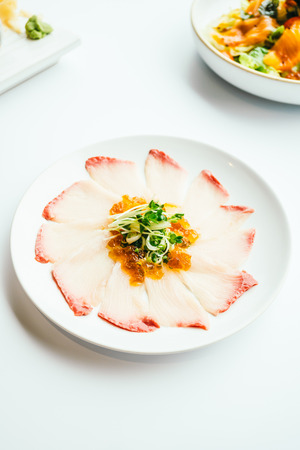 Raw fresh Hamaji fish meat sashimi in white plate , Japanese food style - Color Filter Processing