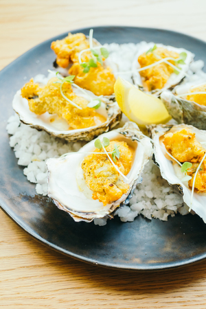 Fried oyster shell with sauce in plate - Color Filter Processing