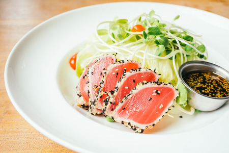 Raw fresh tuna meat with vegetable salad - Vintage light Filter Stock Photo