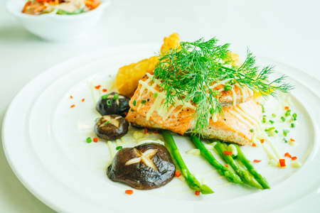 Grilled salmon meat fillet steak with vegetable in white plate - Filter Processing Stock Photo