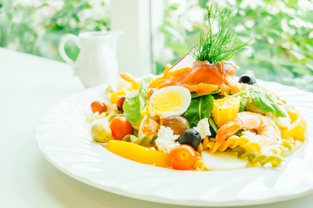 Mixed seafood with fresh vegetable salad in white plate - Healthy food style