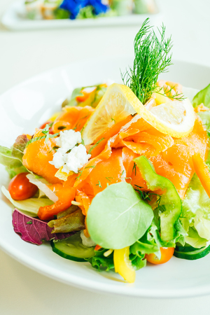 Smoked salmon meat with vegetable salad in white plate - Helathy food style