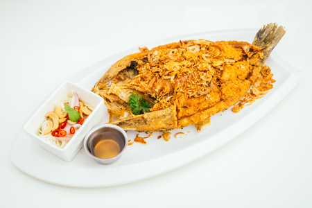 Fried sea bass meat fish with sauce - Thai food style