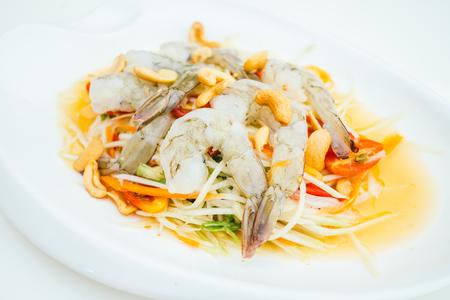 Green papaya spicy salad with raw shrimp or prawn - Thai food style