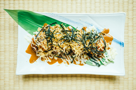 Takoyaki squid ball in white plate - Japanese food style Lizenzfreie Bilder