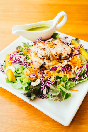 Grilled chicken meat with vegetable salad in white plate - Healthy food style