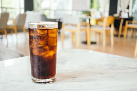Iced cola drinking glass on table Lizenzfreie Bilder