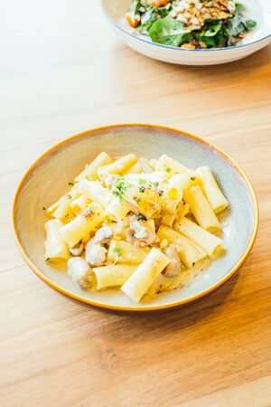 Pasta with mushroom and cream sauce in plate - Italian food style