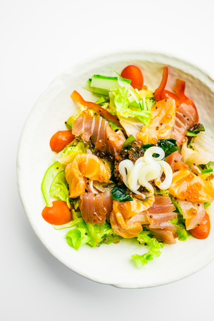 Mixed seafood and vegetable salad with salmon tuna squid and other fish sashimi in white plate - Color Filter Processing , Japanese food style
