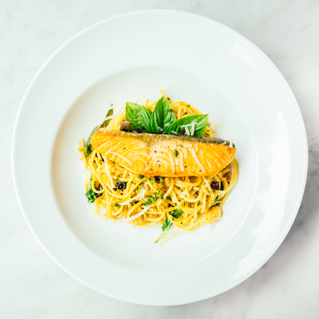 Spaghetti and Pasta with salmon fillet meat in white plate - Italian food style