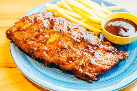 Grilled Bbq or Barbecue rib with french fries and sauce