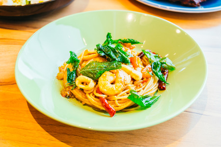 Spaghetti or pasta spicy seafood in plate - Italian food style Lizenzfreie Bilder
