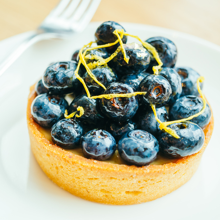 Sweet dessert with blueberry tart in white plate - Color filter Processing
