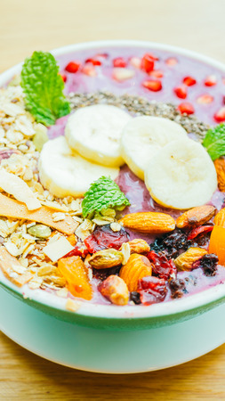 Berry smoothies with banana , almond and other mix fruits in bowl - Healthy food style Lizenzfreie Bilder