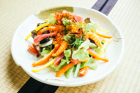Raw and fresh sashimi fish meat with vegetable salad in plate - Japanese food style Lizenzfreie Bilder
