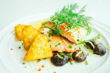 Grilled salmon meat fillet steak with vegetable in white plate - Filter Processing Lizenzfreie Bilder