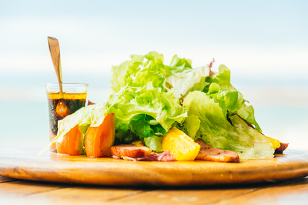 Grilled Duck breast with vegetable salad on wooden plate