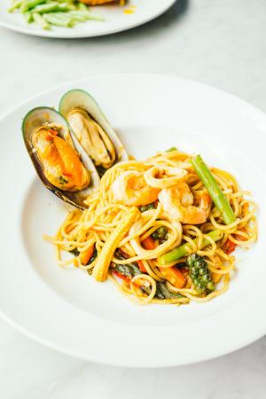 Spaghetti and pasta spicy seafood in white plate - Italian food style Lizenzfreie Bilder