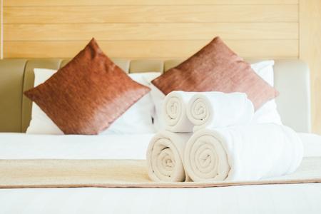 White bath towel on bed decoration in bedroom interior Lizenzfreie Bilder
