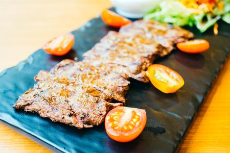 Grilled beef meat steak with vegetable and sauce Lizenzfreie Bilder