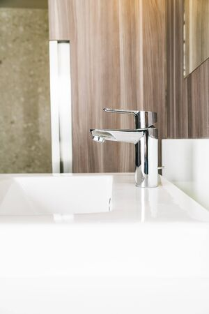 White modern sink and faucet in bathroom interior