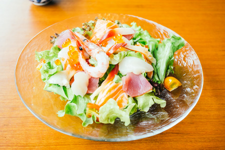 Raw fresh sashimi with vegetable salad - Japanese food style , color Filter Processing