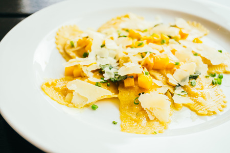 Ravioli pasta with pumpkin and cheese in white plate Stock Photo