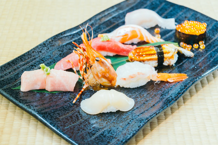 Mixed Raw and fresh salmon tuna shrimp and other sushi - Japanese food style Stock Photo