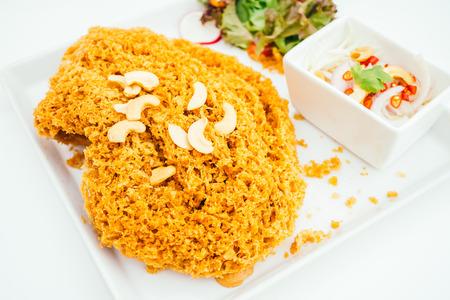 Crispy catfish salad with spicy sauce - Thai food style Stock Photo