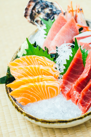 Raw and fresh salmon tuna and other sashimi fish meat - Japanese food style