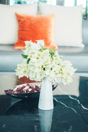 living room sofa: Flower vase on table decoration