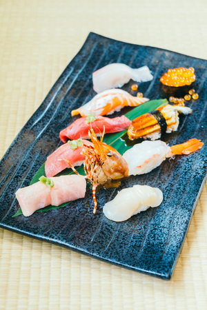 Mixed Raw and fresh salmon tuna shrimp and other sushi - Japanese food style Stock Photo