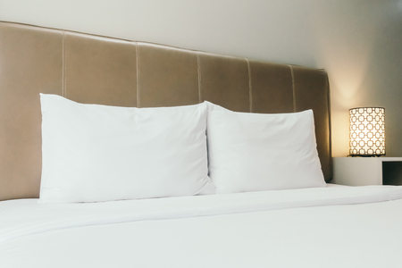 white sheet: White pillow on bed decoration in bedroom interior Stock Photo